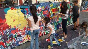 Målning av kulturkalastavlan på en stor textilduk - Kulturkalaset september 2017